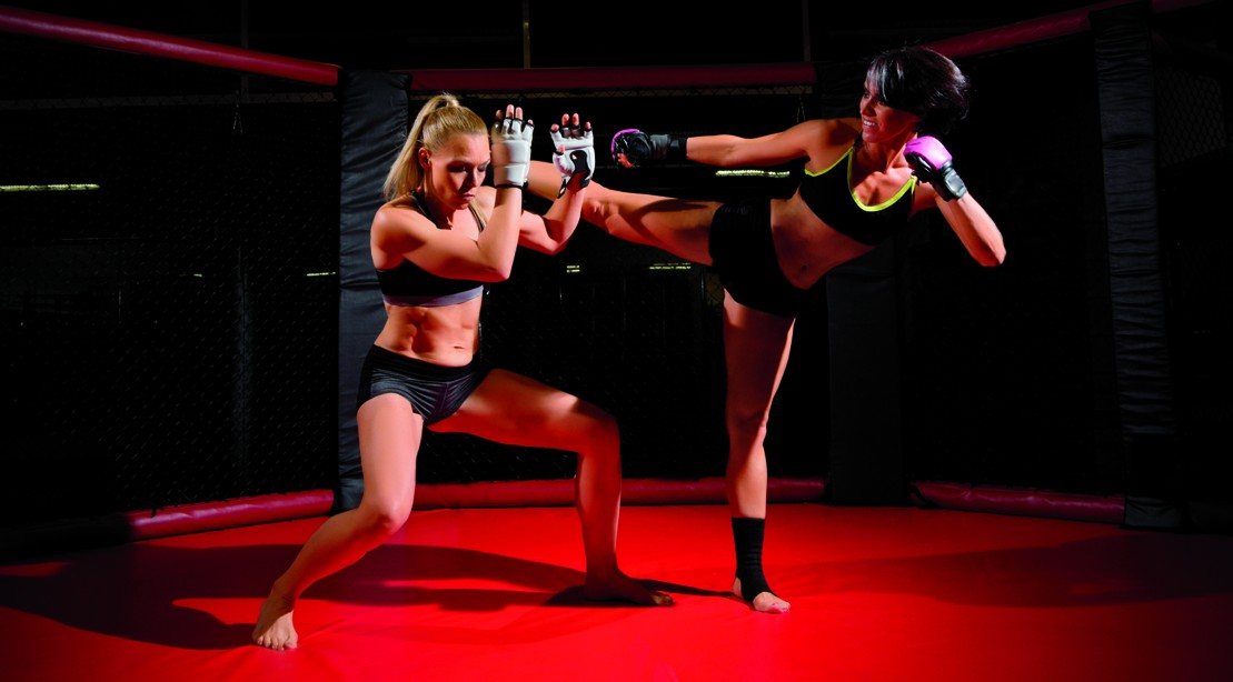 MMA Female Athletes Sparring In The Octagon