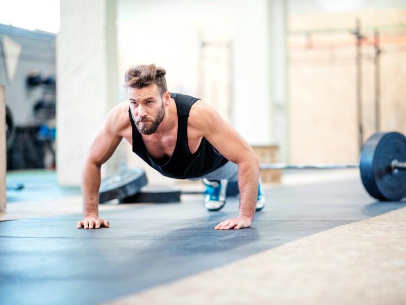 Man performing pushup in gym