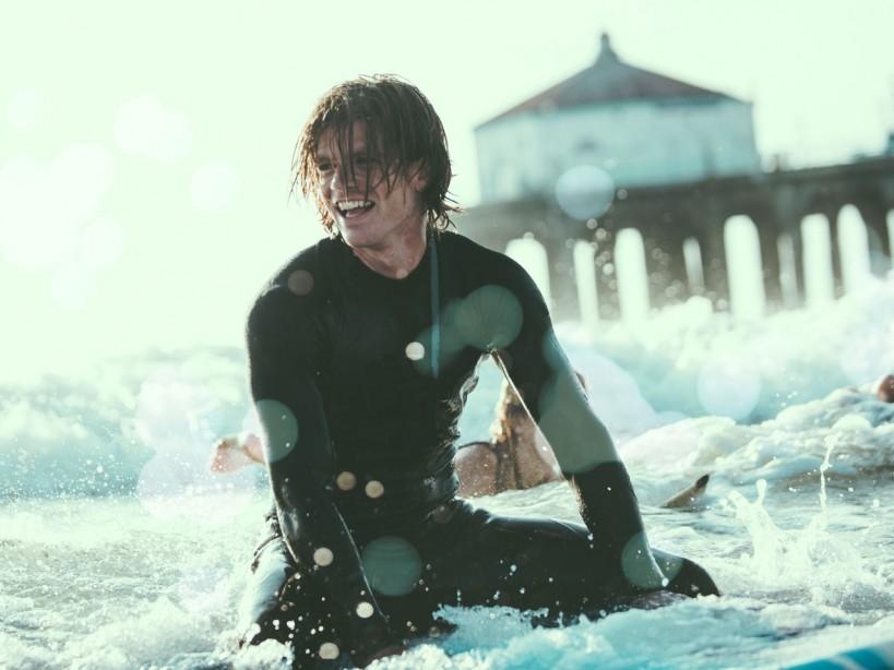 Happy guy surfing