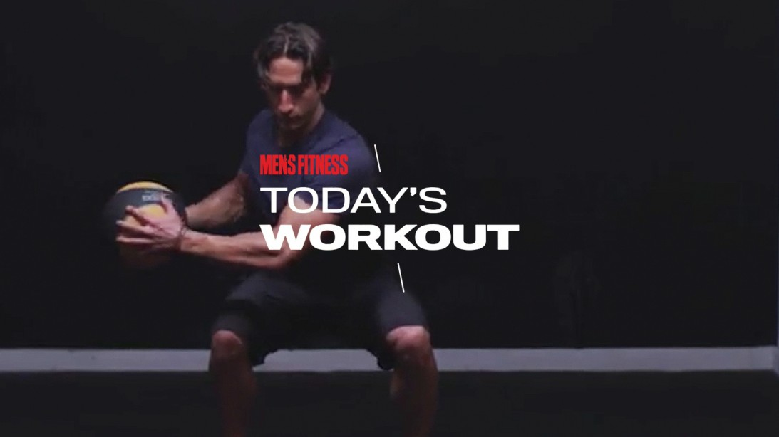 Man Does Medicine Ball Russian Twist Exercise