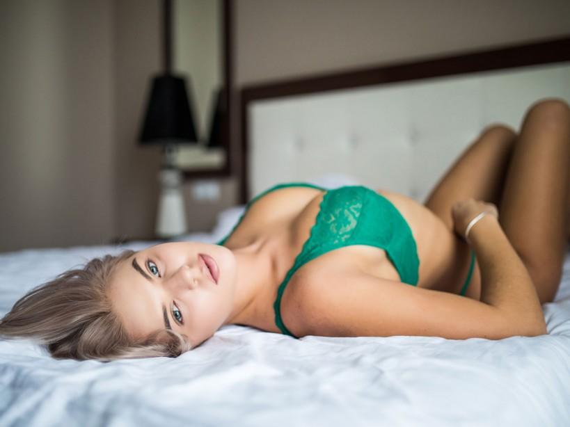 Woman wearing lingerie lying in bed