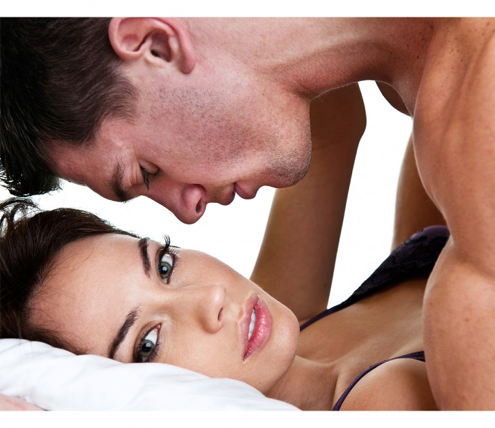Sexy love women and men on the bed