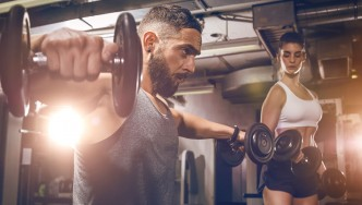 Man and Woman Training with Dumbbells