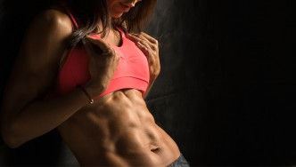 Female-Leaning-Showing-Abs