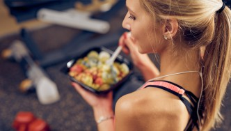 Fitness-Girl-Eating-Salad