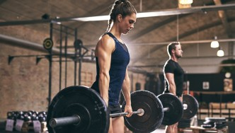 Girl-Doing-Barbell-Deadlift-Gym