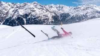 Girl-Falling-On-Ski-Skiis-Flying-in-Air.