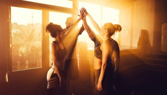 Group-Fitness-High-Fiving-Sunset
