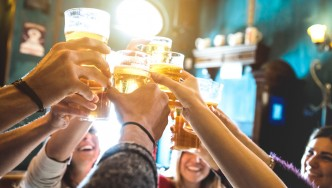 Group-Of-Friends-Cheering-With-Glass-Of-Beer