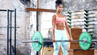 HERS-Female-Performing-Barbell-Deadlift