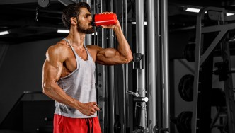 A man drinking a protein shake.