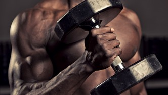 Male-Holding-Dumbbell