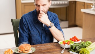 Man-Making-Dietary-Decisions-Burger-Salad