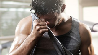 Man-Wiping-Sweat-With-Shirt