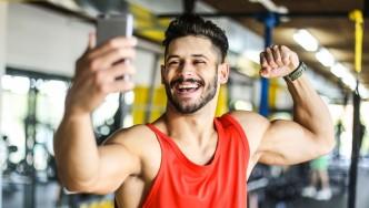 Man taking selfie in gym