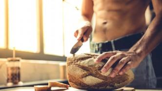 Muscular-Guy-Cutting-Loaf-Bread