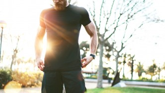 Muscular-Man-Standing-In-Front-Of-Sunrise
