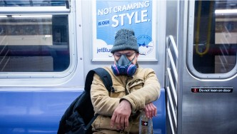 New Yorker Wearing Face Mask Riding The MTA Subway During Coronavirus Pandemic
