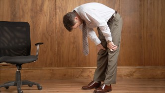 Office-Male-Hunched-Over-Back-Pain