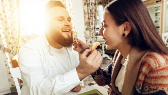 Pudgey-Male-With-Beard-Feeding-Girlfriends-French-Fry