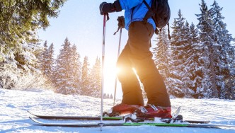 Skier-Standing-On-Skiis-Ski-Sunset-Snowy-Snow-Mountain