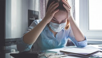 Stressed-Out-Coronavirus-Female-Working-With-Face-Mask