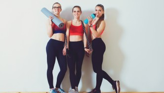 Three-Girls-Posing-Fitness-Gear-white-wall