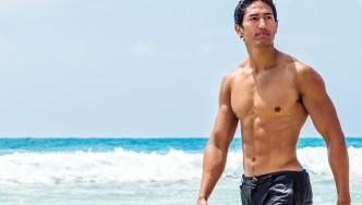 Wet-Muscular-Asian-Male-In-Ocean