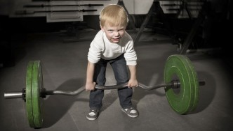Young-Boy-Trying-To-Lift-Barbell