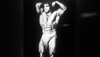 Bodybuilder Franco Columbu Posing Onstage