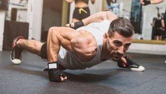 Man Doing One-arm Pushup