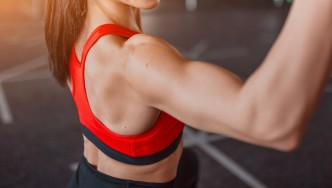 Woman Training Shoulders in the Gym