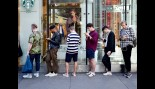 Men Using Smart Phones While Standing in Line thumbnail