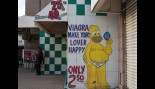 Viagra medication advertisement is displayed outside a pharmacy in Tijuana, Mexico thumbnail