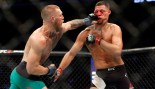 Conor McGregor hits Nate Diaz with a left during their welterweight rematch at the UFC 202. thumbnail