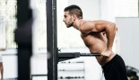 Man performing bodyweight dip thumbnail