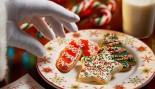 Santa Grabbing Christmas Cookies miniatura