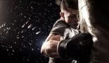 Man throwing a punch at boxing punching bag thumbnail