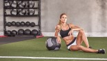 Torrie Wilson on the floor with a medicine ball thumbnail