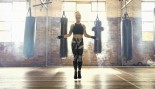 Woman jumping rope in boxing gym thumbnail