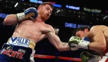 Canelo Alvarez punches Julio Cesar Chavez Jr. during their catchweight bout at T-Mobile.  thumbnail