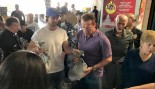 Arnold Schwarzenegger Hands Out Turkey to Homeless thumbnail