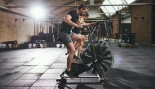 Man And Woman On Airdyne Bike At Gym thumbnail