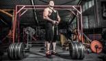 Bodybuilder-Big-Man-Preparing-For-Deadlift-Wrist-Straps-Barbell thumbnail
