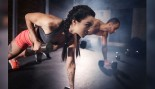 Man And Woman Doing Plank Rows With Dumbbells  thumbnail