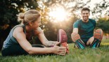 Healthy-Happy-Couple-Stretching-Grass thumbnail
