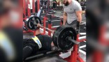 Larry Wheels benching 405 pounds 25 times thumbnail