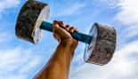 Lifting-Heavy-Stone-Dumbbell-Sky thumbnail