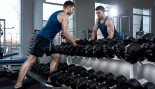 Male-At-Dumbbell-Rack-Looking-In-Mirror thumbnail