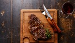 Grilled Steak Striploin and red wine on cutting board thumbnail